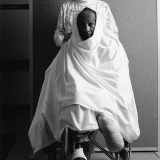 Nurse and Sheet-Covered Patient